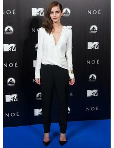 Emma Watson wears a long-sleeved silk J.Mendel jumpsuit styled with Gianvito Rossi black leather and clear PVC slip-on shoes to the Madrid premiere of Noah