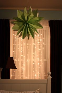 Lights strung from window. Want to do this in master bedroom, not sure how it would look from the outside though.