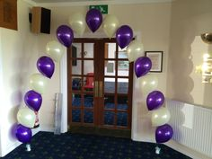 Door arch in purple and ivory.