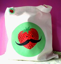 A Salvador Strawberry tote for all those carnival game prizes you'll be winning!  Another Etsy find from Kikichoo.