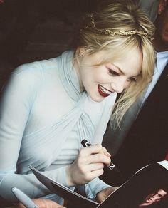 Emma signing autographs.