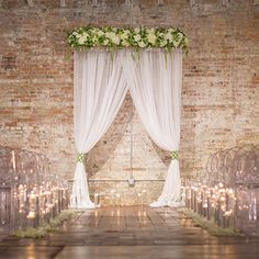 Dress up a modern loft with draped fabric and flowers.Related: 25  of the Most Unique Wedding Themes We've Ever Seen