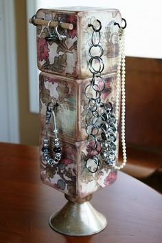 jewelry holder.  Looks like kids blocks.  Would be a good idea when you only have a few items of jewelry to organize.