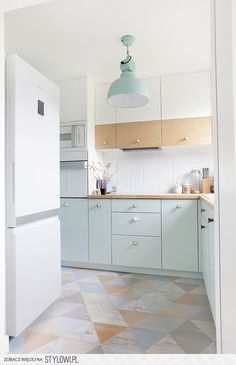 Lots to love! The playful colour combinations, the backsplash tiles, the lamp.