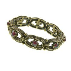 Slip on chic modern style with this gold tone link stretch bracelet from our 2028 Collection. Antique gold tone embellished links are given a punch of pigment with purple amethyst Lucite stones.