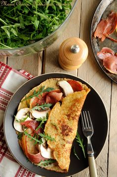 Crêpe gourmande à l'épeautre, son d'avoine et origan, garnie de coppa toastée, parmesan, champignons frais et roquette