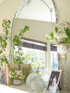 spring mantel- Use an old mirror from a dressing table for the mantelpiece in the lounge.