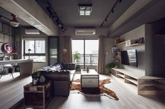 Industrial with room partition doors opened http://www.home-designing.com/2014/07/fabulous-marvel-heroes-themed-house-with-cement-finish-and-industrial-feel