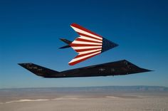 Two specially painted F-117 Nighthawks fly on one of their last missions. The F-117s were retired March 11 2008 in a farewell ceremony at Wright-Patterson Air Force Base, Ohio. (U.S. Air Force photo/Senior Master Sgt. Kim Frey)