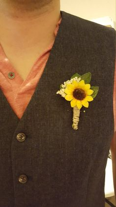 Thus is a rustic sunflower boutonniere with a twine bow. I can incorporate different flowers or colors of ribbon upon request. Also, if you