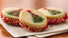 Easy to make!  Christmas Tree Sandwich Cookies    1 package (13oz) Pillsbury Ready To Bake Shape Christmas tree sugar cookies.    3/4 cup vanilla frosting (from 1-1 b container frosting.    Candy Sprinkles