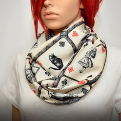 Handmade Alice in Wonderland themed infinity scarf. With characters from classic book by Lewis Carroll Alice in Wonderland - Alice, White Rabbit, Mad Hatter, Cheshire Cat, Queen of Hearts, Mock Turtle and Duchess . Perfect accessory for any outfit ! A continuous loop allows to wear the infinity scarf in several different ways. Long enough to wrap it twice on you neck. Printed on cream colored poly cotton mix fabric and finished in double layer tube style - no raw edges. Measurements approx…