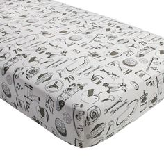Shop Pit Crew Race Car Crib Fitted Sheet.  Our Pit Crew Race Car Crib Fitted Sheet is made from soft cotton and features lively prints of roadside favorites.  Perfect for your boy's nursery.
