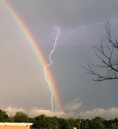 A double rainbow appears in the sky as lightning strikes during a severe thunderstorm on May 1 in Hamilton, Ohio.