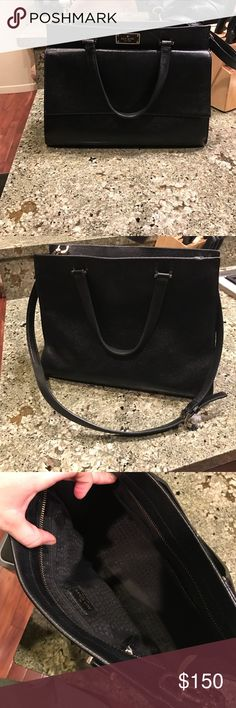 Kate Spade luxury black purse This has been hardly used(went back to my love Marc Jacobs) black and very professional look. Large strap to use as cross body or handles for sleek look. Pet/Smoke free home kate spade Bags Shoulder Bags