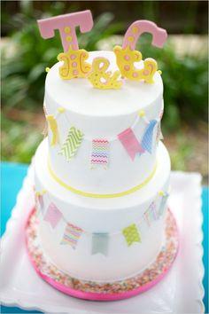 carnival themed wedding cake with rainbow stripes inside #weddingcake #caketopper #weddingchicks http://www.weddingchicks.com/2014/02/04/country-fair-wedding/