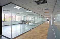 Glass partitions create a more welcoming and open space. If you are looking for a glass partition company in Dubai that helps you with various options and designs, contact Al Basira. Fill out the contact form on our website or give us a call to know more. Glass Office Partitions, Glass Partition Wall, Glass Wall Design, Office Floor Plan, Types Of Wood Flooring, House Staircase, Glass Room, Modern Office Design, Office Walls