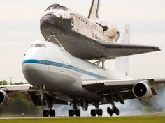 Paul J. Richards / AFP - Getty ImagesThe Space Shuttle Discovery makes its final landing on the back of a NASA Boeing 747 Shuttle Carrier Aircraft (SCA), at Washington, Dulles International airport on April Washington Dulles International Airport, Nasa Space Program, Real Steel, Air And Space Museum, Boeing 747, New Politics, Space Shuttle, Science Nature, Space And Astronomy
