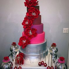 "Beautiful wedding cake covered in giant 6"" Red Peony Sugarflowers."