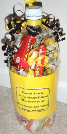 "Graduation Gift ( creative container with $ in it) maybe fill with money nd all candies that have ""smart"" references. ""smartees"" ""100 grand"" etc"
