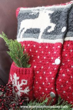 4 goodwill christmas sweater turned into pillows, christmas decorations, repurposing upcycling, seasonal holiday decor, I decided to keep the little pockets on the front I thought they would be cute with sprigs of cedar or possibly secret notes from Santa Noel Christmas, Christmas Pillow, Country Christmas, Ugly Christmas Sweater, Christmas Stockings, Xmas Sweaters, Christmas Colors, Sweater Pillow, Old Sweater