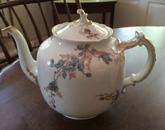 Original Price $320 - Now $160  Antique Haviland Limoges Tea Set Tea Pot - Covered Sugar Bowl - Cream Pitcher  Back stamp is shown and dates this china to the late 1800s  This is a lovely old Haviland pattern featuring a blue floral design and special gold accent trim on all three pieces. This floral pattern covers a large portion of these antique pieces  With the exception of a 3/8 inch chip at the base of the sugar bowl - see picture - this Haviland Tea Set is in very good condition wi...