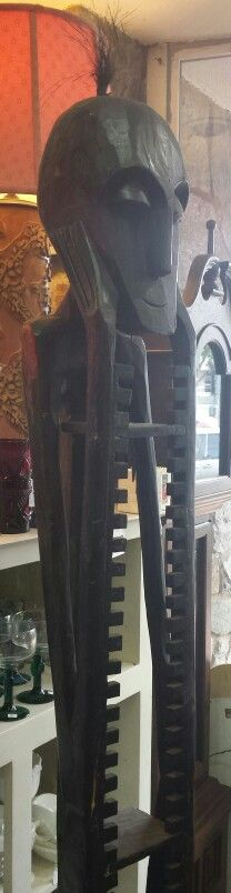 Giant wood carved African inspired DVD tower