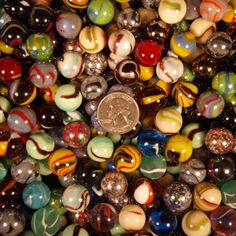 marbles- reminds me of when I was a kid and we played in the school yard. Log rollers were my favorite!!  Those were the days...