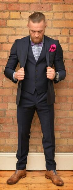 Men's Navy Three Piece Suit, White and Navy Gingham Dress Shirt, Brown Leather Brogues, Purple Print Bow-tie Mcgregor Suits, Conor Mcgregor Style, Connor Mcgregor, Three Piece Suit, 3 Piece Suits, Sharp Dressed Man, Well Dressed Men, Moda Formal, Blue Suit Men