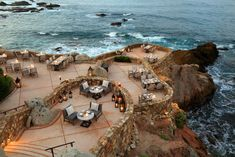 A multitiered dining area at Cocina del Mar, one of the property's restaurants, is set into the cliffs (and lit at night for the full effect).