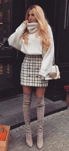 White turtle neck top and check skirt outfit
