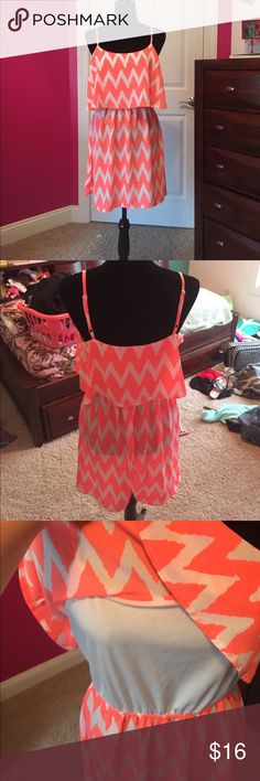 Dress Coral and white chevron dress. Super cute and very stylish. The top part has a slip but the bottom does not so it is see through would need a slip. I just don't own one. Super cute! Had adjustable straps! Lowest is $16 Rue21 Dresses Strapless