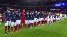 The French team stood arm in arm as both sides lined up to sing the national anthems in fr...