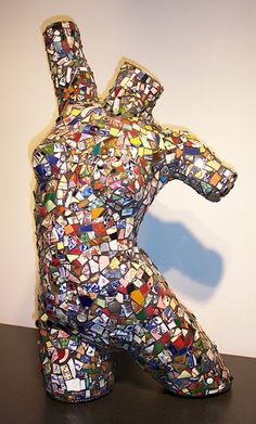 Awesome mosaic manequin. Would look really cool in the garden!