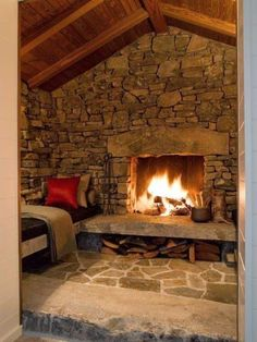 Cabin Fireplace Design- Great remodeling idea for the lower level fireplace nook/ seating area. And I think I may know someone who can make concrete blenches to match the stone fireplace! - home me