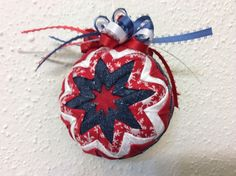 Red, white and denim quilted ball