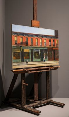 "Edward Hopper's ""Early Sunday Morning"" (1930), on his easel at the Whitney Museum of American Art."