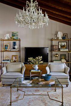 Bookshelf styling - Emily Henderson.  Living Room_Chair Coffee Table Shelf Chandelier
