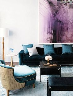 Purple living room art: loving the deep blue furniture