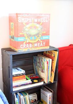 "Crates from Michaels made into bookshelves in a little boy's nautical / pirate bedroom by Simply Klassic Home --- Kristen said: ""I stained them with Minwax Ebony stain, let them dry for a few days, then whitewashed and sanded them."" Wow! What a great idea!"