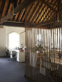 rope room divider, just knotted on ends to wooden dowels.