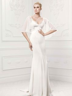 Get ready to exude pure elegance in this flawless sheath #weddingdress! Satin sheath gown offerscontoured empire bodice with geometric body seaming and attached chiffon caplet. Truly Zac Posen at David's Bridal Style ZP341413. #davidsbridal