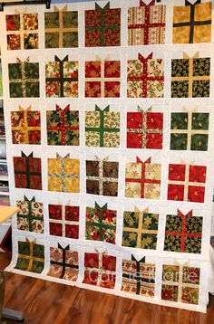 The quilt top is done!!!   This was a pattern from Jenny Doan's tutorial - the Present Quilt.  (Missouri Star Quilt Company.  It was completed using my Baby Lock Tempo and charm packs from Robert Kaufman's Holiday Flourish Metallic.