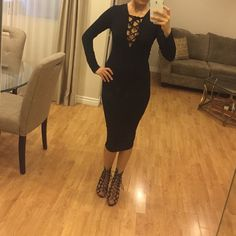 Lace Up Black Midi Dress Super Soft, Beautiful and So Stylish! Lace Up Deep V-Neck Black Midi Dress!  BRAND NEW in package!  Size Small  95% Rayon  5% Spandex Made in U.S.A. Dresses Midi