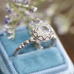 I am in love with this ring! It is so gorgeous!!!!! Floral Engagement Ring in 14k White Gold Pebble by LaMoreDesign