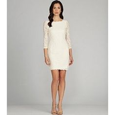 Beautiful ivory lace dress From Adrianna Papell, this cocktail dress features: lace sheer illusion yoke boat neckline 3/4 sleeves back zipper clsoure approx. 39 inch Adrianna Papell Dresses Midi