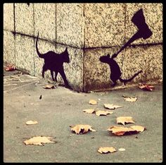 Street Art. Cat and mouse.