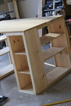 DIY bookshelf desk / craft table. Made from the 'MODERN CARFT TABLE' plan at http://ana-white.com/2010/09/modern-craft-table (Try this one which is similar: http://ana-white.com/2010/02/plans-bedford-project-table-top-with.html ) #deskplansdiy