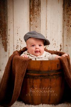 Three month old baby boy in a vintage wooden bucket