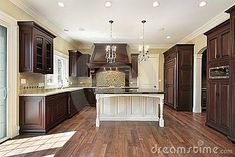 46 Kitchens With Dark Cabinets (Black Kitchen Pictures) Dark kitchen cabinets look absolutely stunning. Get some great ideas and view our pictures of kitchens with dark, grey or black kitchen cabinets. Dark Wood Cabinets, Dark Kitchen Cabinets, Kitchen Cabinet Doors, Kitchen Cabinet Design, Kitchen Units, Cherry Cabinets, Diy Kitchen, Island Kitchen, Kitchen Ideas